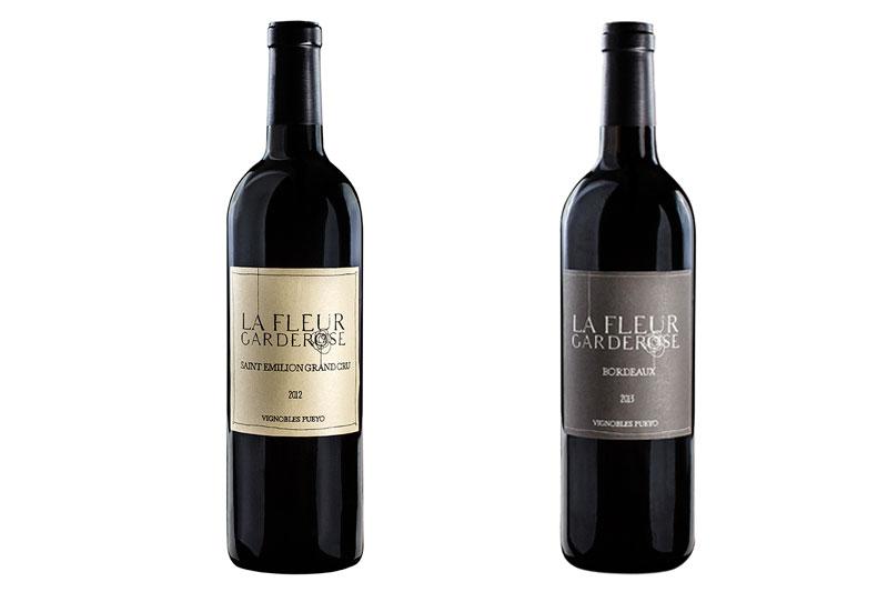 Photo, packshot d'une bouteille de vin. Saint Emilion grand cru, Bordeaux, Libourne. Chateau, Vignobles Pueyo